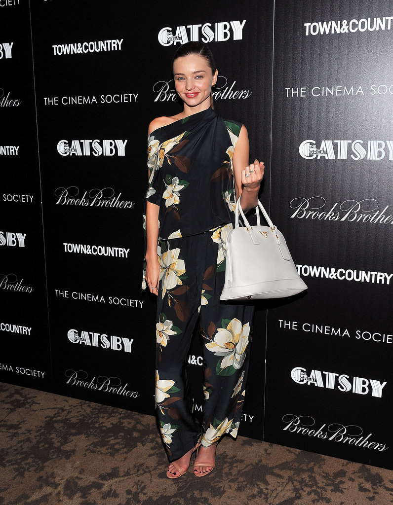 Miranda Kerr worked a floral jumpsuit with a white Prada bag at a screening of The Great Gatsby in NYC.