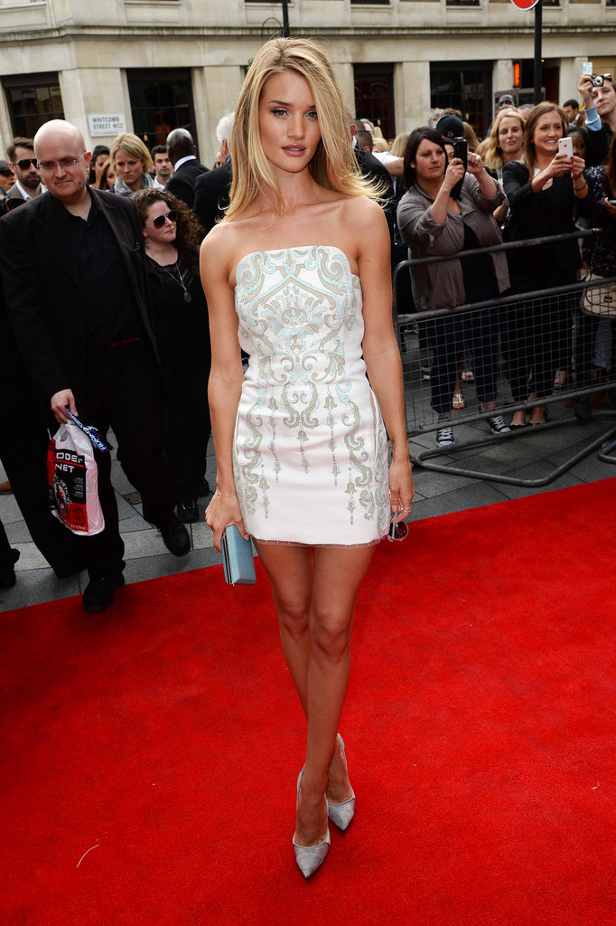 At the Hummingbird premiere in London, Rosie Huntington-Whiteley put her skinny jeans away in lieu of a white strapless Emilio Pucci minidress.