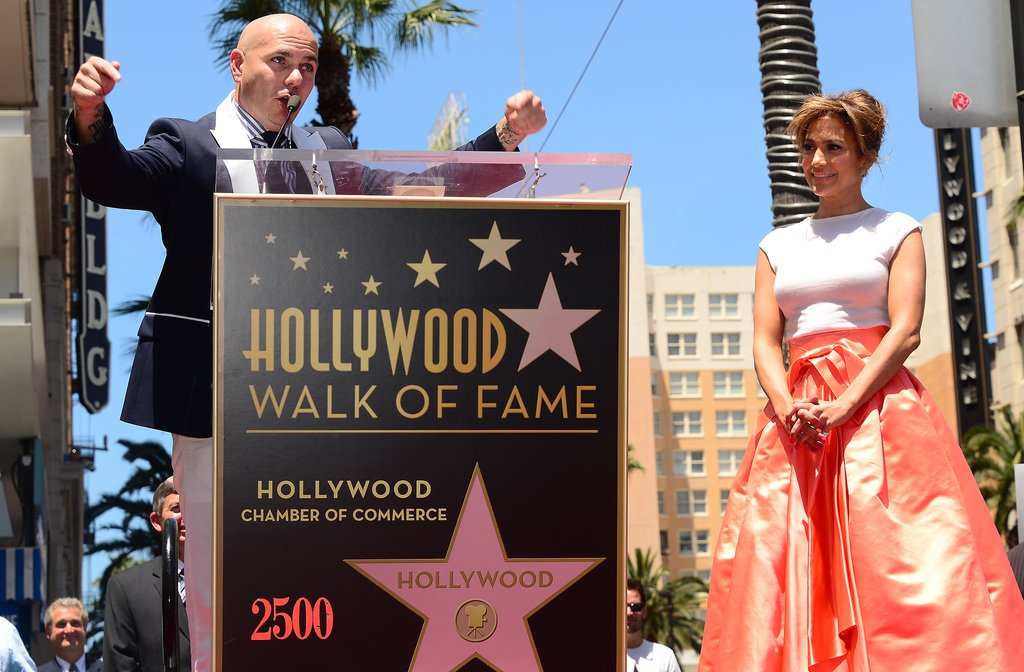 Pitbull spoke at Jennifer Lopez's Walk of Fame star unveiling on Thursday in LA.