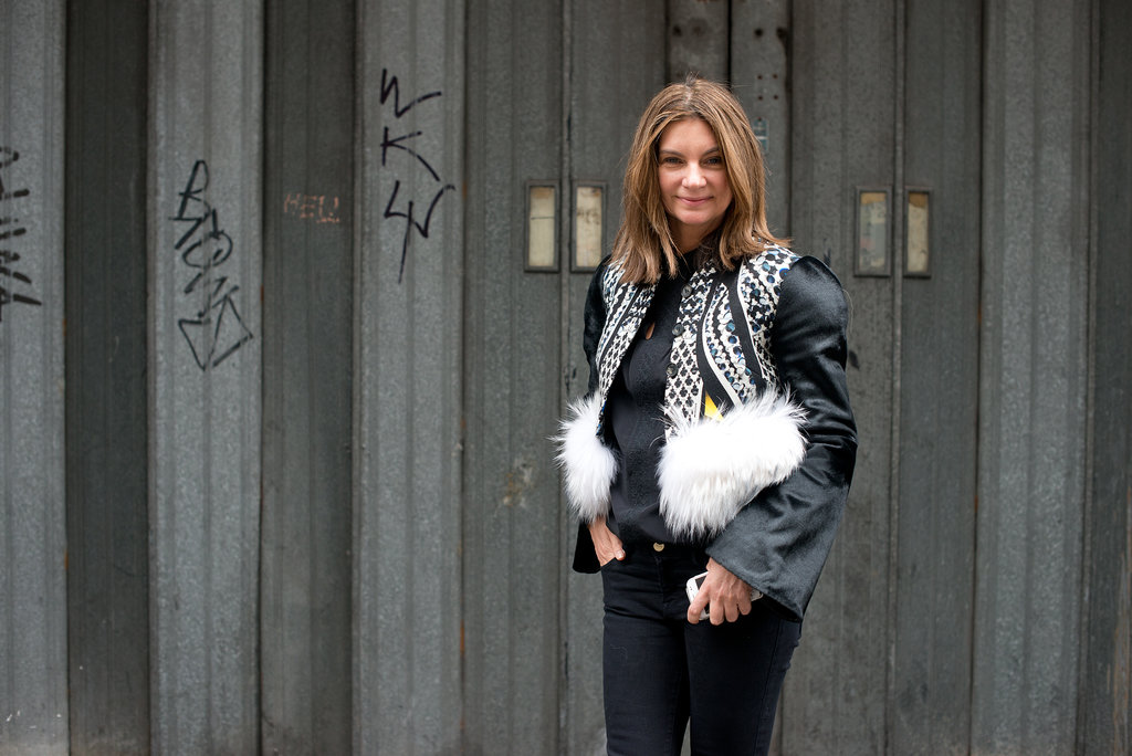 Behold the power of layers. This quirky vest took her black blouse to boho-luxe fashion territory.
