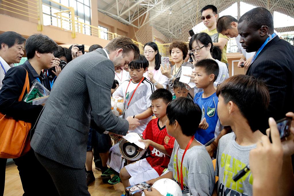 Victoria Beckham Balances Work and Play in Beijing