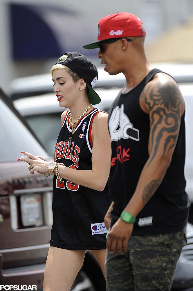Miley Cyrus walked with a male friend.