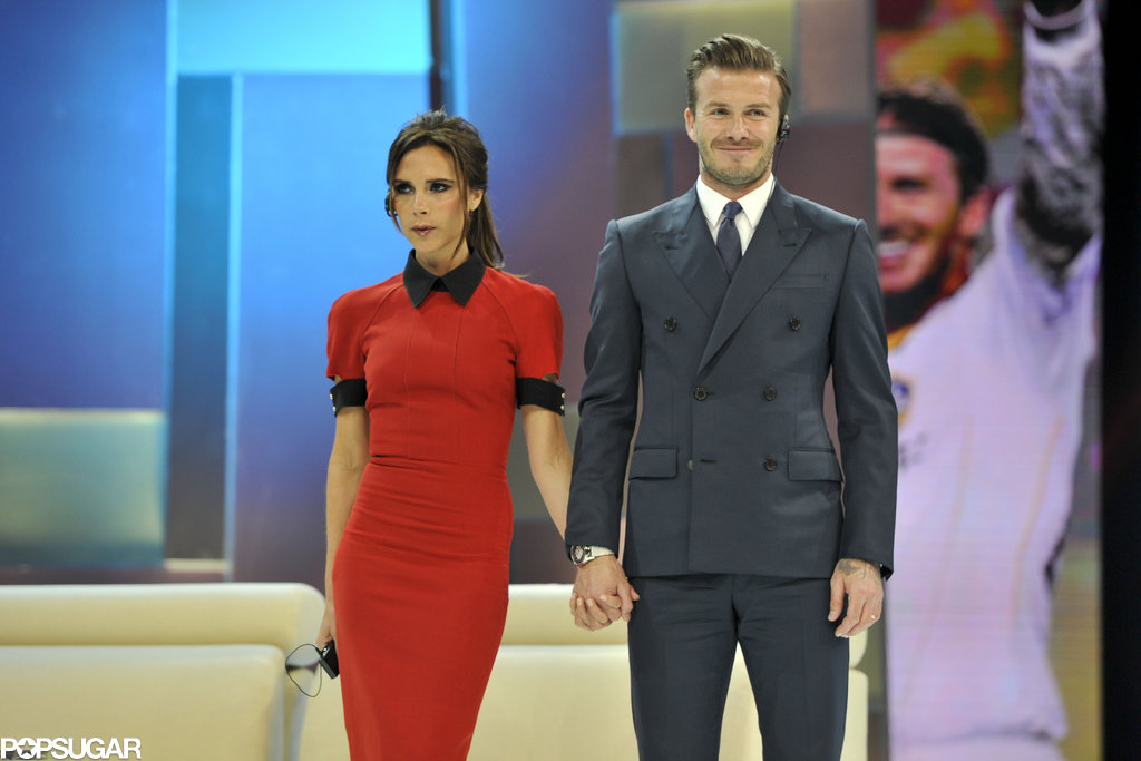Victoria Beckham wore a dress of her own design for a stop on China Central Television with David Beckham.