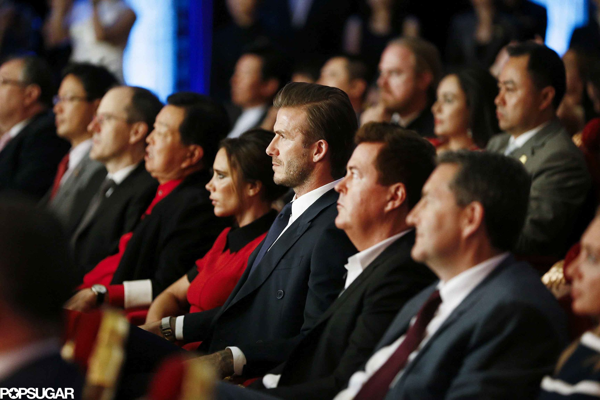 David Beckham put his hand on Victoria Beckham's lap while they watched the Peking Opera. Source: Tungstar/Splash News Online