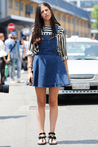She embraced the overall trend with a denim dress version and a sharp black-and-white striped blouse.