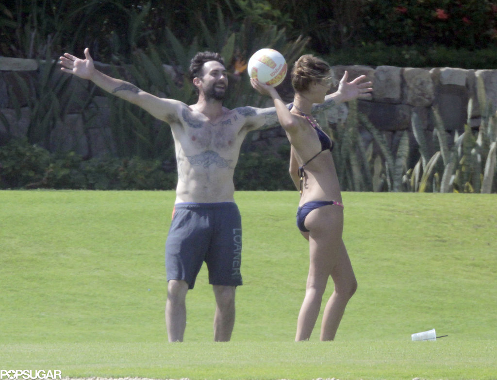 Nina Agdal threw the ball while playing with Adam Levine.