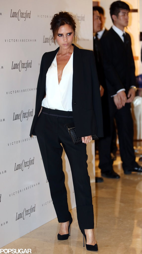 Victoria Beckham wore a black and white ensemble for an appearance in Beijing.