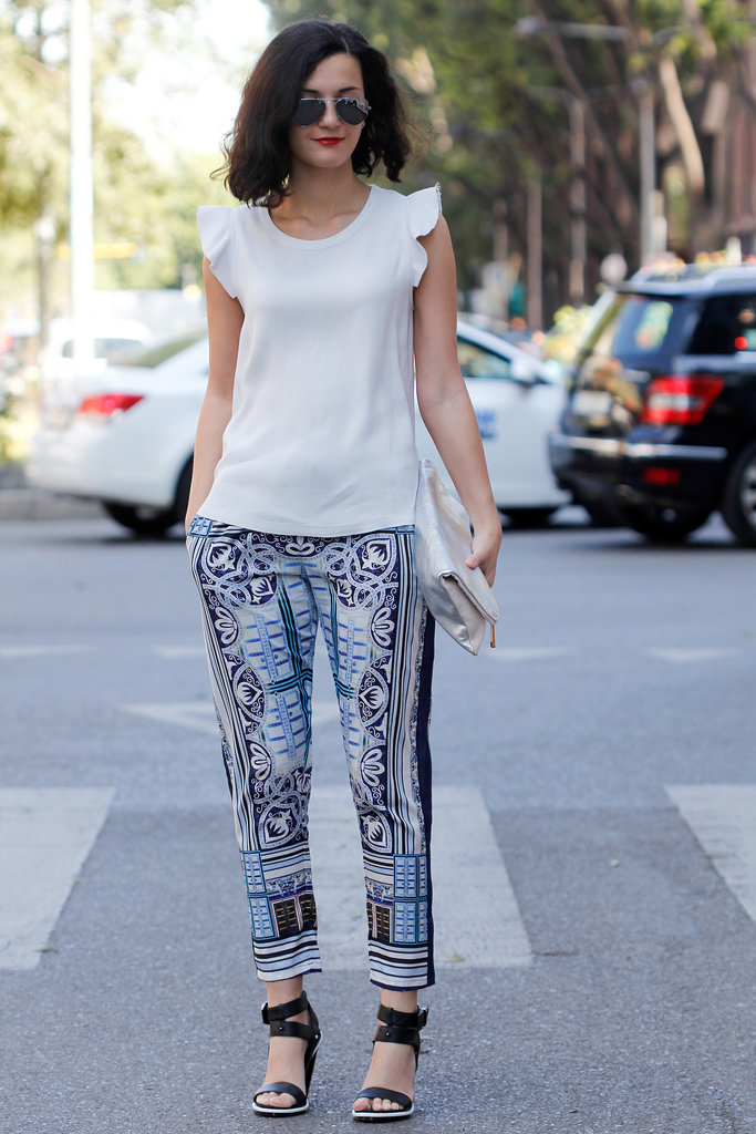 This showgoer kept it easy and on trend in a pair of printed trousers and a feminine-feeling blouse.