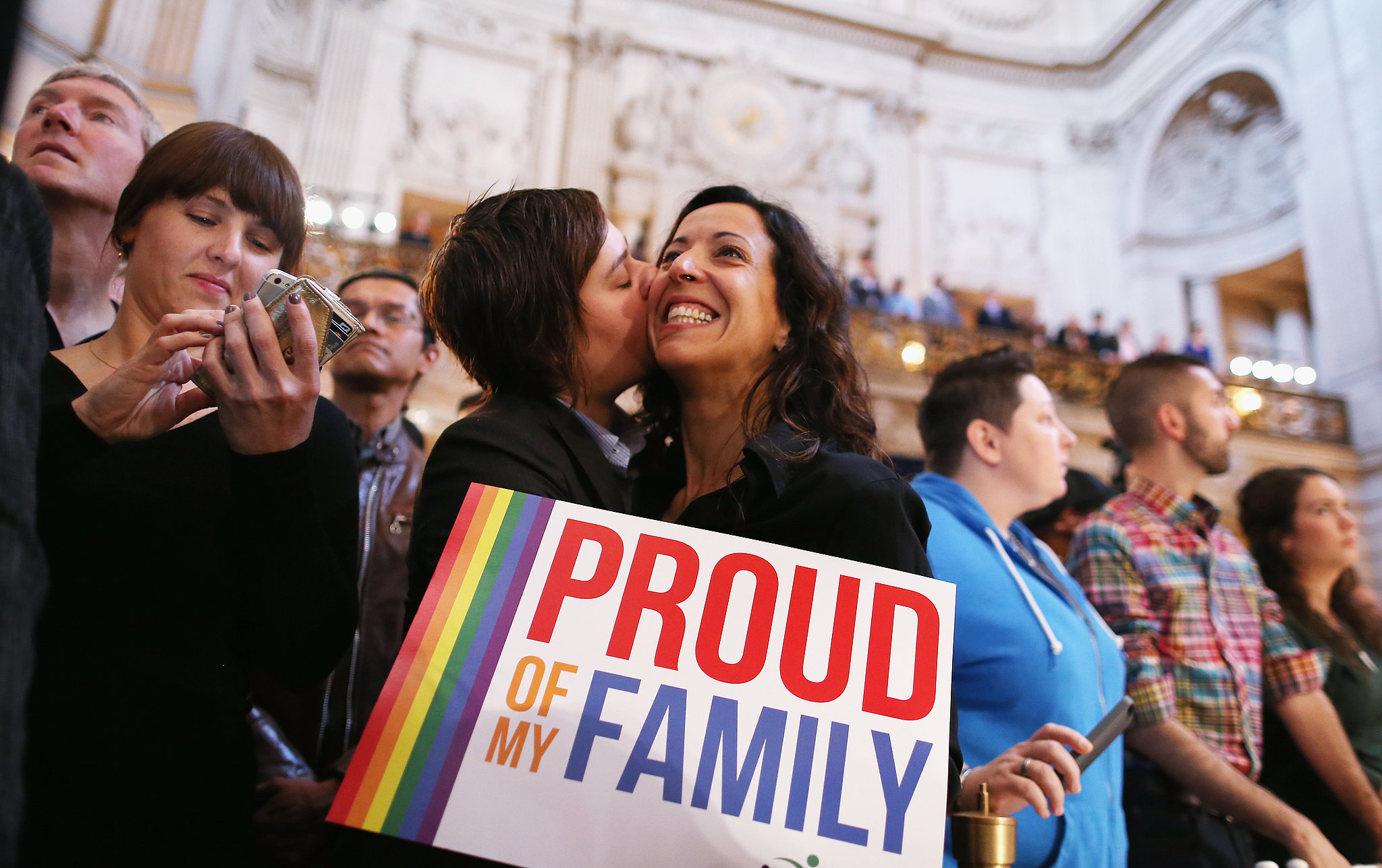 A couple shared celebratory kisses at SF City Hall after hearing the US Supreme Court's rulings on gay marriage.
