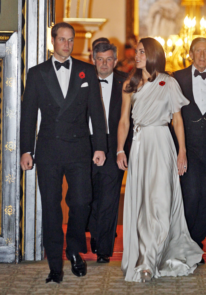 Kate Middleton and Prince William wore red poppies on their clothes as they attended a November 2011 reception for the National Memorial Arboretum Appeal at St. James' Palace.