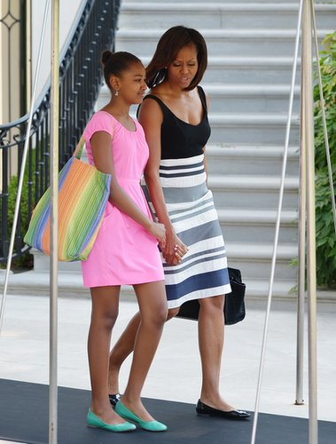 Michelle Obama looked resort chic in a striped dress and patent ballet flats as she and daughter Sasha made their way to board Marine One in Washington, D.C.