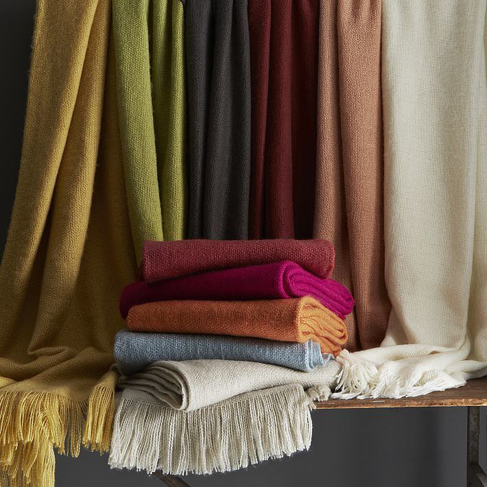 A cozy, colorful West Elm Throw ($20-$29) is perfect for late-night feeding sessions.