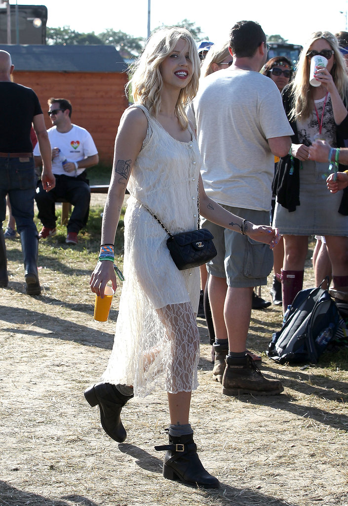 It looks like the little white dress isn't just a Summer trend stateside! Peaches Geldof picked a lace version to hit the turf.