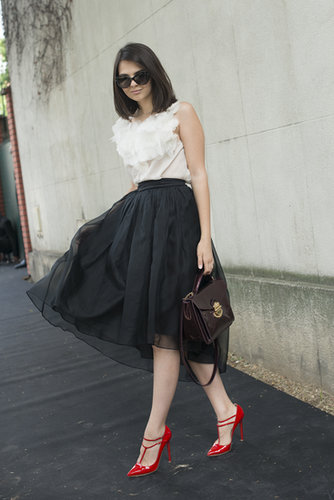 Classic black and white was brightened up by a vibrant red shoe.