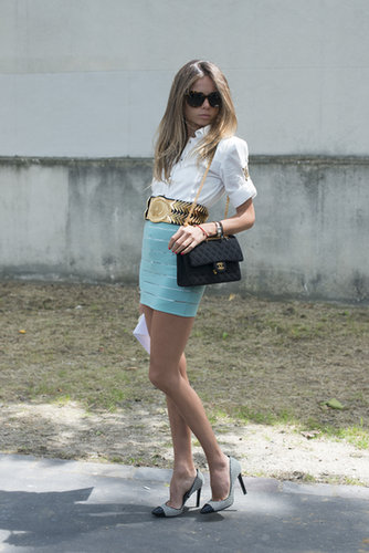 A miniskirt, heels, and fresh white button-down always look right on trend.