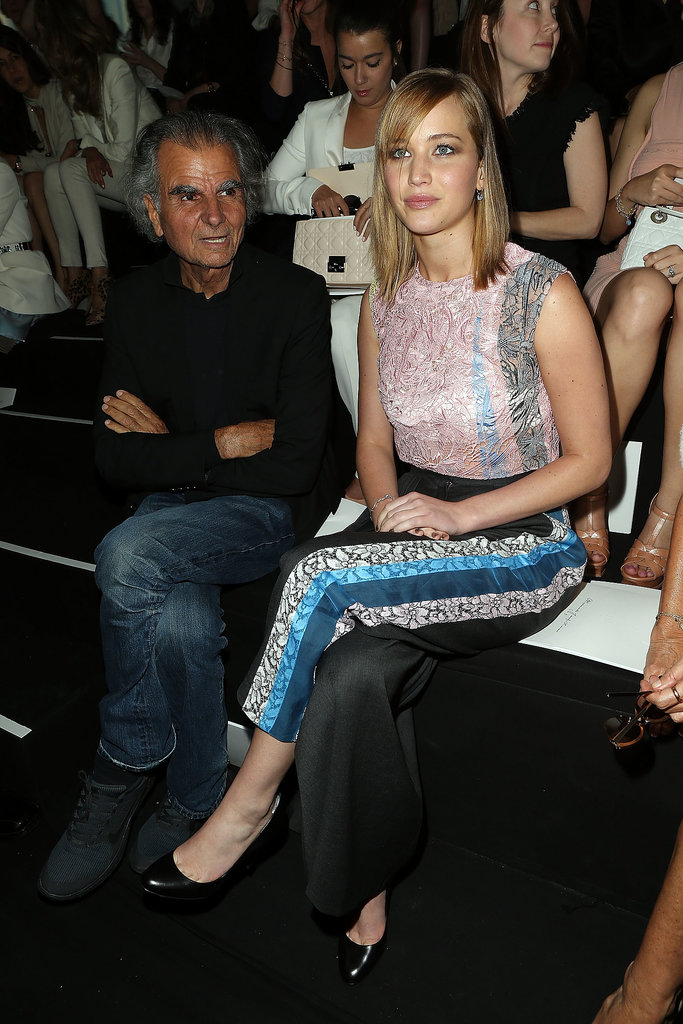 Jennifer Lawrence sat front row next to fashion photographer Patrick Demarchelier at the Christian Dior Haute Couture runway show on Monday.