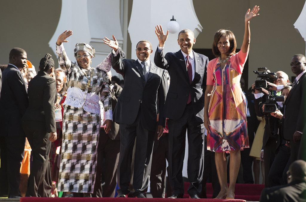 In Tanzania, the Obamas waved alongside Tanzanian President Jakaya Kikwete and First Lady Mama Salma Kikwete in July.