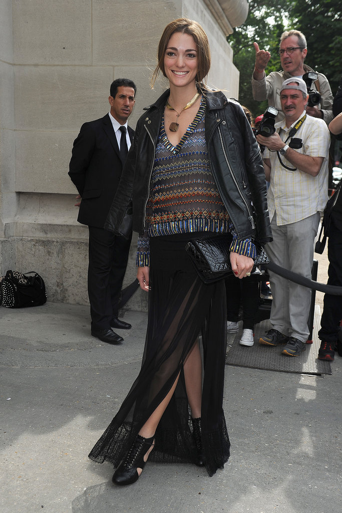A high slit provided some breeze for this showgoer, who topped off her skirt with a patterned sweater and moto jacket.