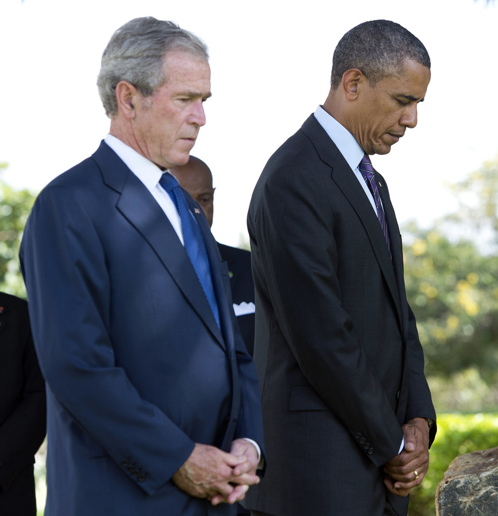 At the July wreath-laying ceremony for victims of the 1998 US Embassy bombing in Tanzania, President Obama and former President Bush bowed their heads in respect.