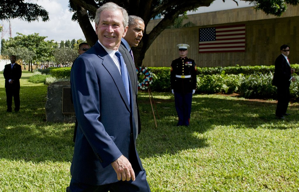 In July, former President George W. Bush smiled next to President Obama as they arrived at the wreath-laying ceremony for victims of the 1998 US Embassy bombing in Tanzania.