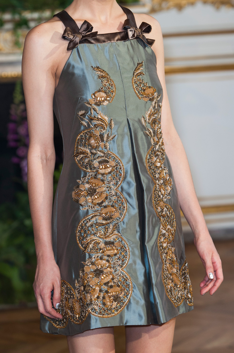 Alexis Mabille opted for a metallic blue half-moon manicure, with a silver semicircle accenting the bottom of the models' nails.