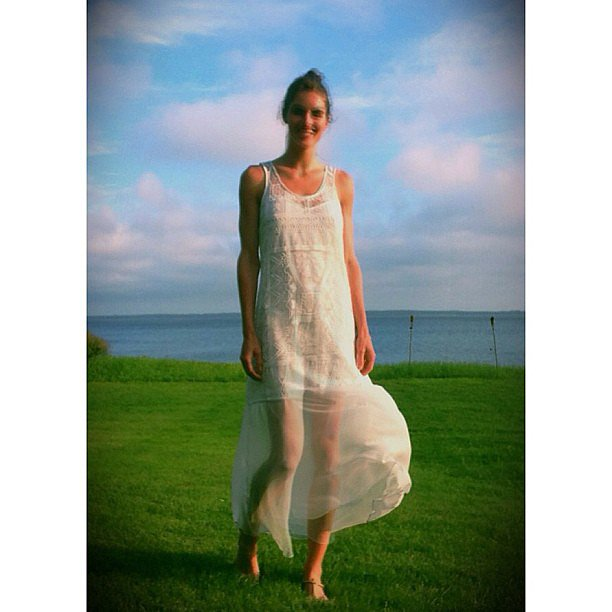 Hilary Rhoda shared a dreamy snap while on vacation — how pretty is that billowy white dress? Source: Instagram user hilaryhrhoda
