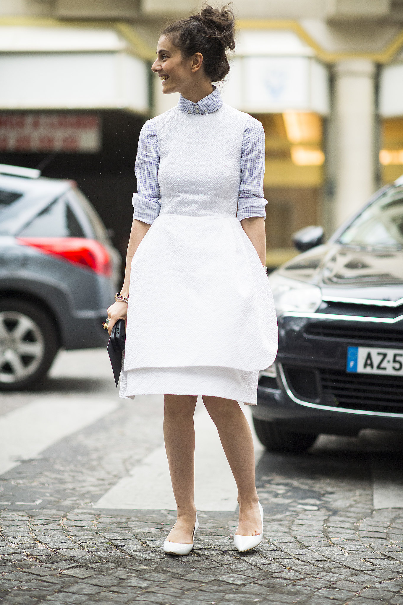 Structured to hold its shape, this white-dress look put a seri