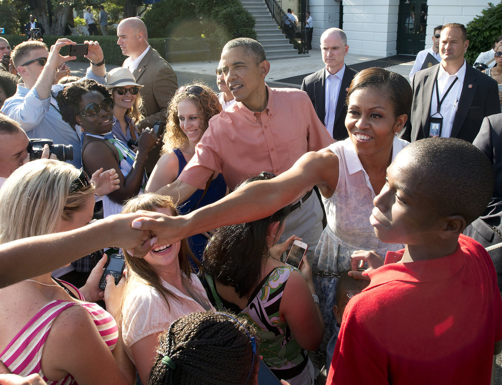 President Obama and First Lady Michelle greeted the crowd during the White House Fourth of July BBQ honoring military families in 2013.