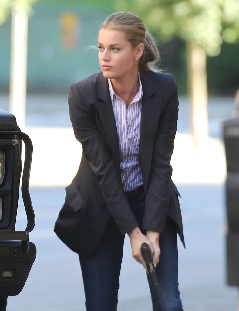 Rebecca Romijn filmed a shoot-out on Thursday while on the set of her new film King & Maxwell in Vancouver, Canada.