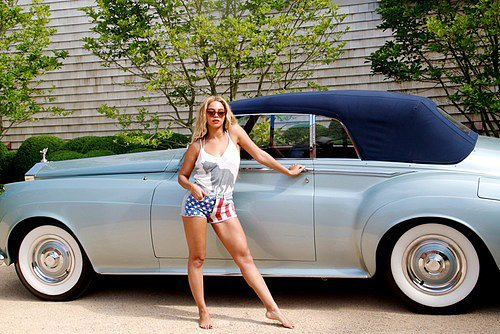 Beyoncé Knowles posed in front of a Rolls-Royce for a Fourth of July shoot. Source: Tumblr user Beyoncé