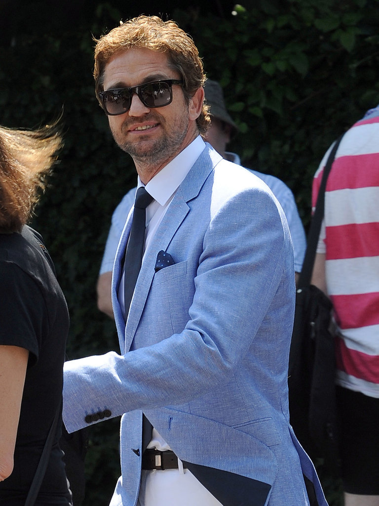 Gerard Butler looked dapper while arriving for the mens final match on Sunday.