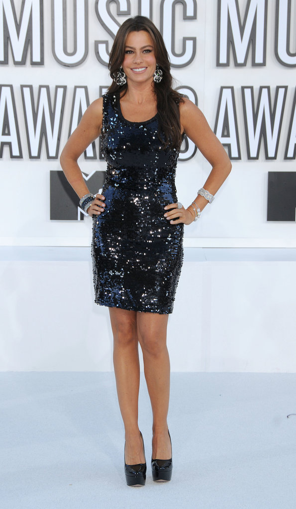 Vergara contrasted the white backdrop of the 2012 MTV VMAs in a glitzy LBD, coordinating platforms, and oversize diamond drop earrings.