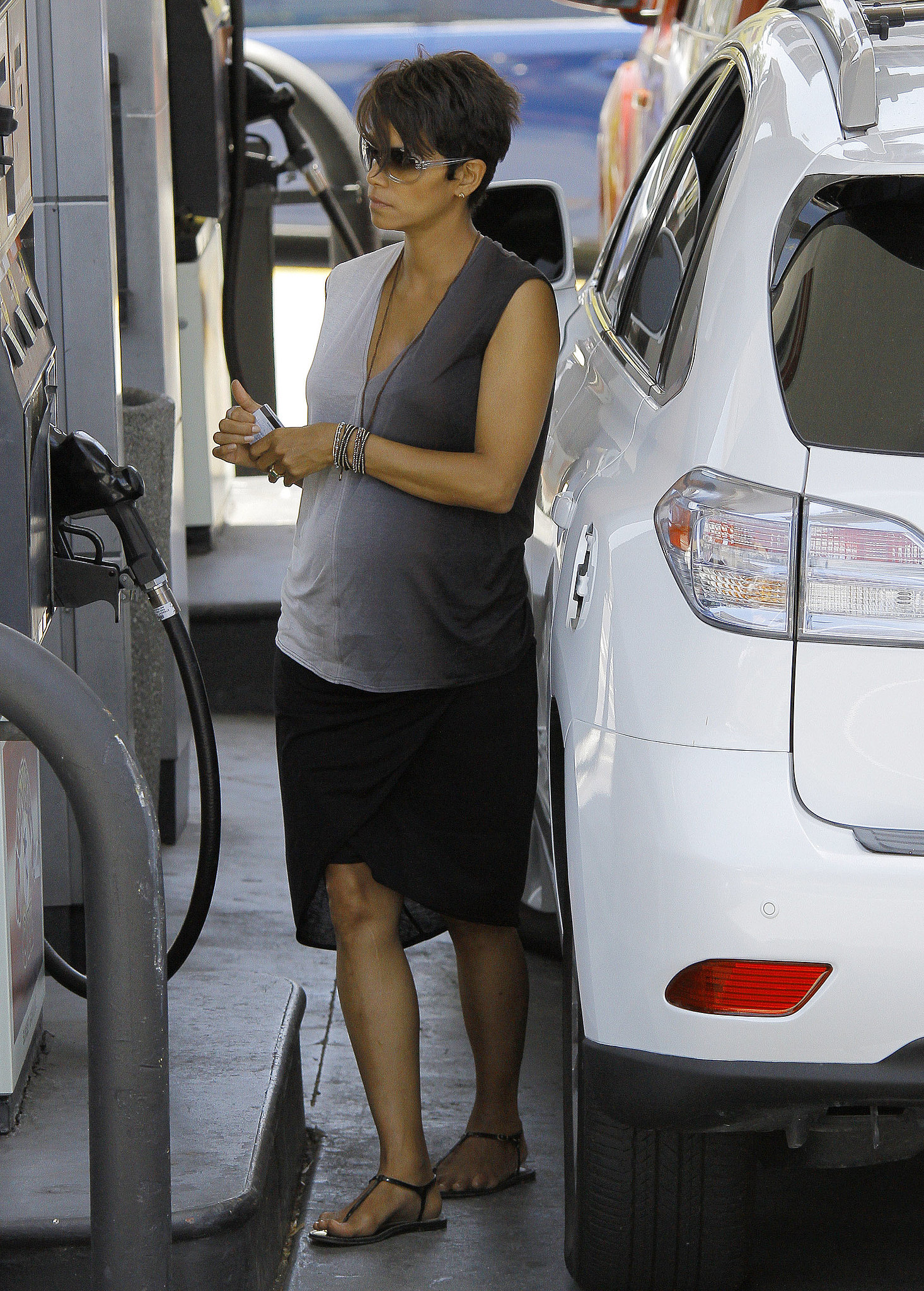A little gas station run didn't stop Halle from looking ultrafashionable in an ombré tank and high-low skirt. Beaded bracelets added much-needed shine.