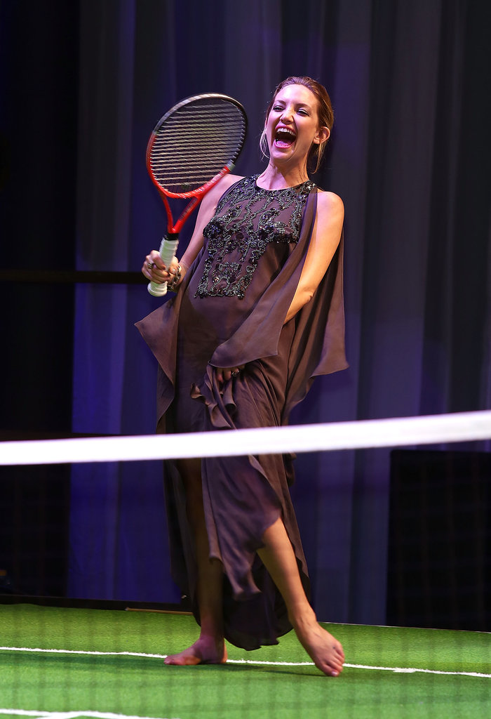 Kate Hudson had a laugh as she shed her heels to play tennis at a London gala.
