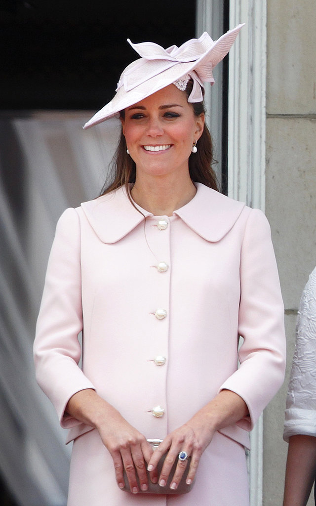 In her final public appearance before maternity leave, Kate's blowout was tucked securely under a pink hat.