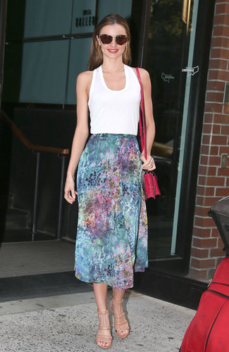 Miranda tucked a white tank into a floral Topshop skirt, then added nude Alexander Wang sandals, Miu Miu sunglasses, and a bold pink bag.