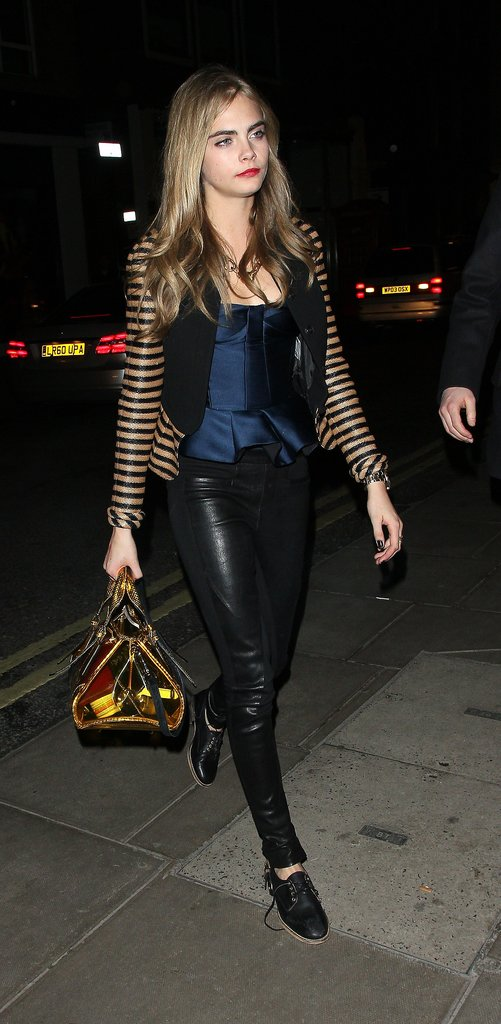 Cara's version of dressing up: peplum-trimmed Burberry, leather pants, and a pair of brogues.
