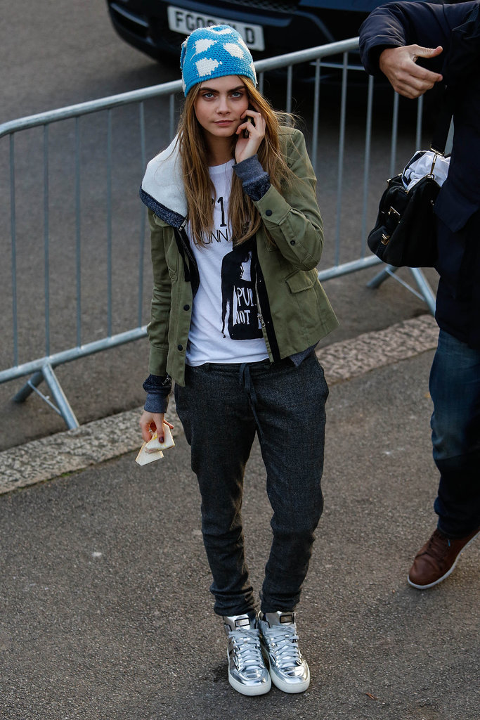 True to form, Cara perfected a borrowed-from-the-boys skater style with an army-green anorak, beanie, and (of course!) a pair of statement sneakers.