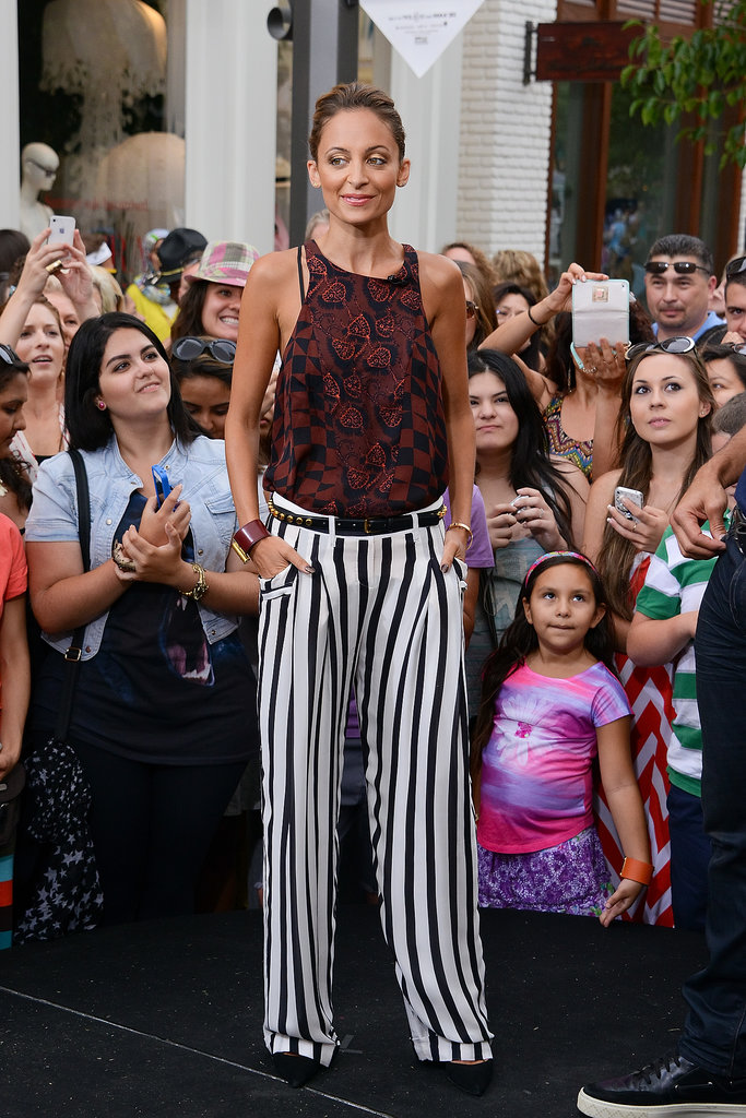 While filming an Extra segment, Nicole Richie mixed prints like a pro in checks and stripes.