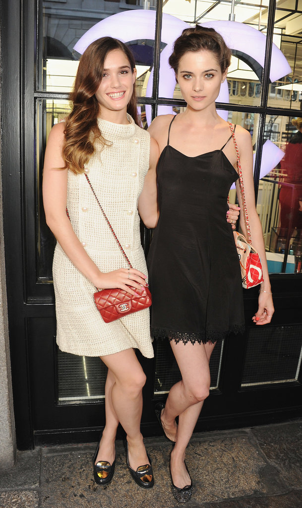 At Chanel's Covent Garden boutique, Sai Bennett and Thea Owens went opposites in black and white dresses.