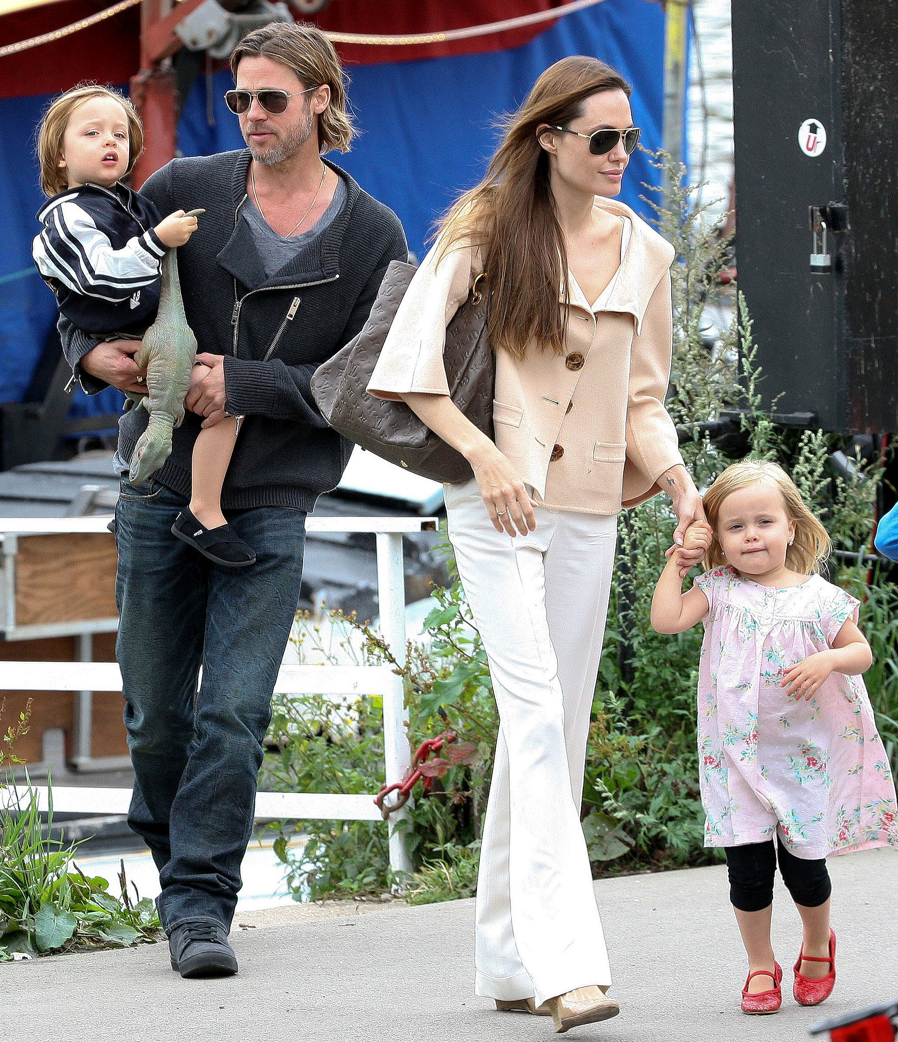 Brad Pitt and Angelina Jolie took Knox Jolie-Pitt and Vivienne Jolie-Pitt to a show on a boat in London in August 2011 with their brothers and sisters.