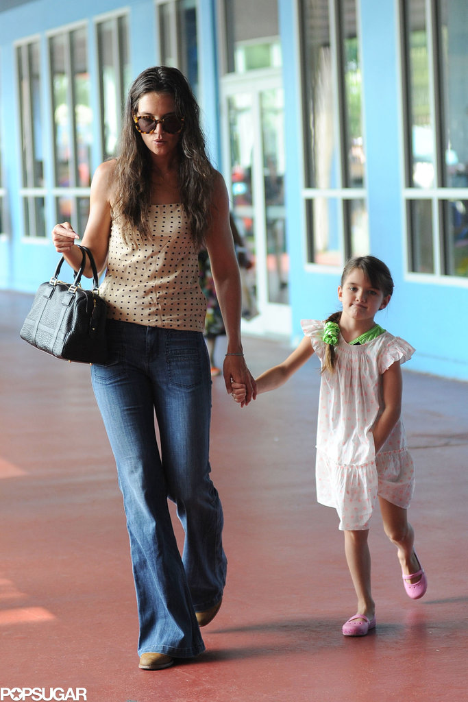 Katie Holmes held onto Suri Cruise's hand while carrying a Loewe purse.