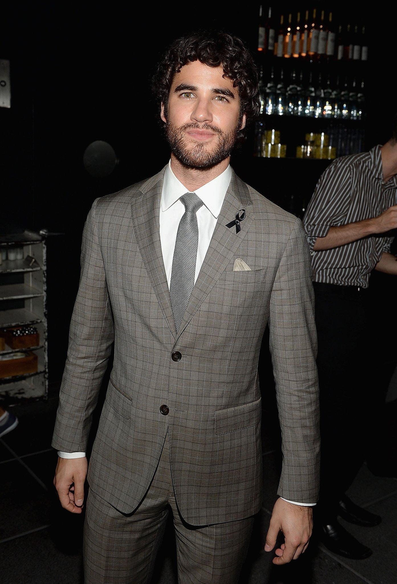 Darren Criss wore a black ribbon on his lapel.