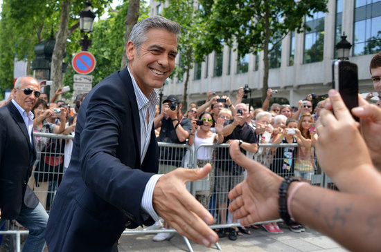 George Clooney greeted fans in Paris.