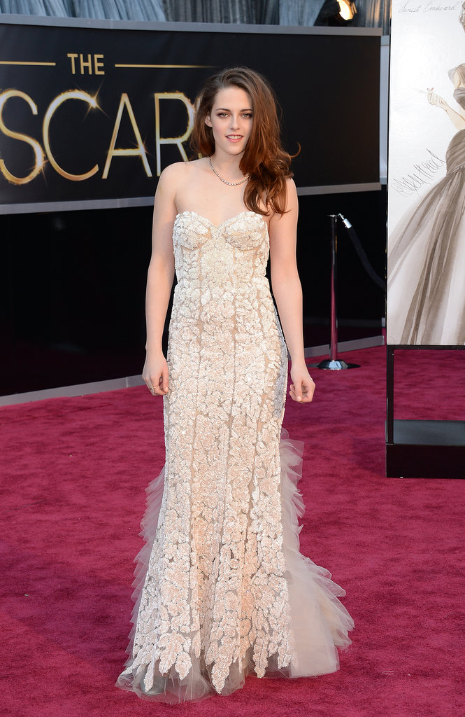 Stewart donned a pale blush Reem Acra gown featuring intricate lace detailing for the 2013 Oscars in February.