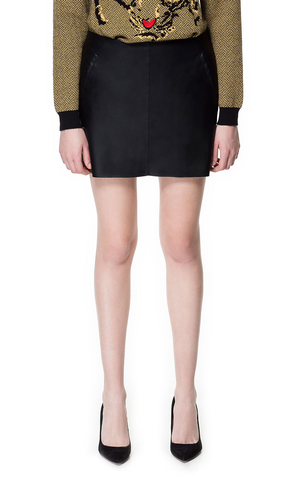 If you're looking for a serious steal, look no further than Zara's Leather Effect Mini Skirt ($30, originally $60). Show off your tan now; add your favorite tights and heels later.