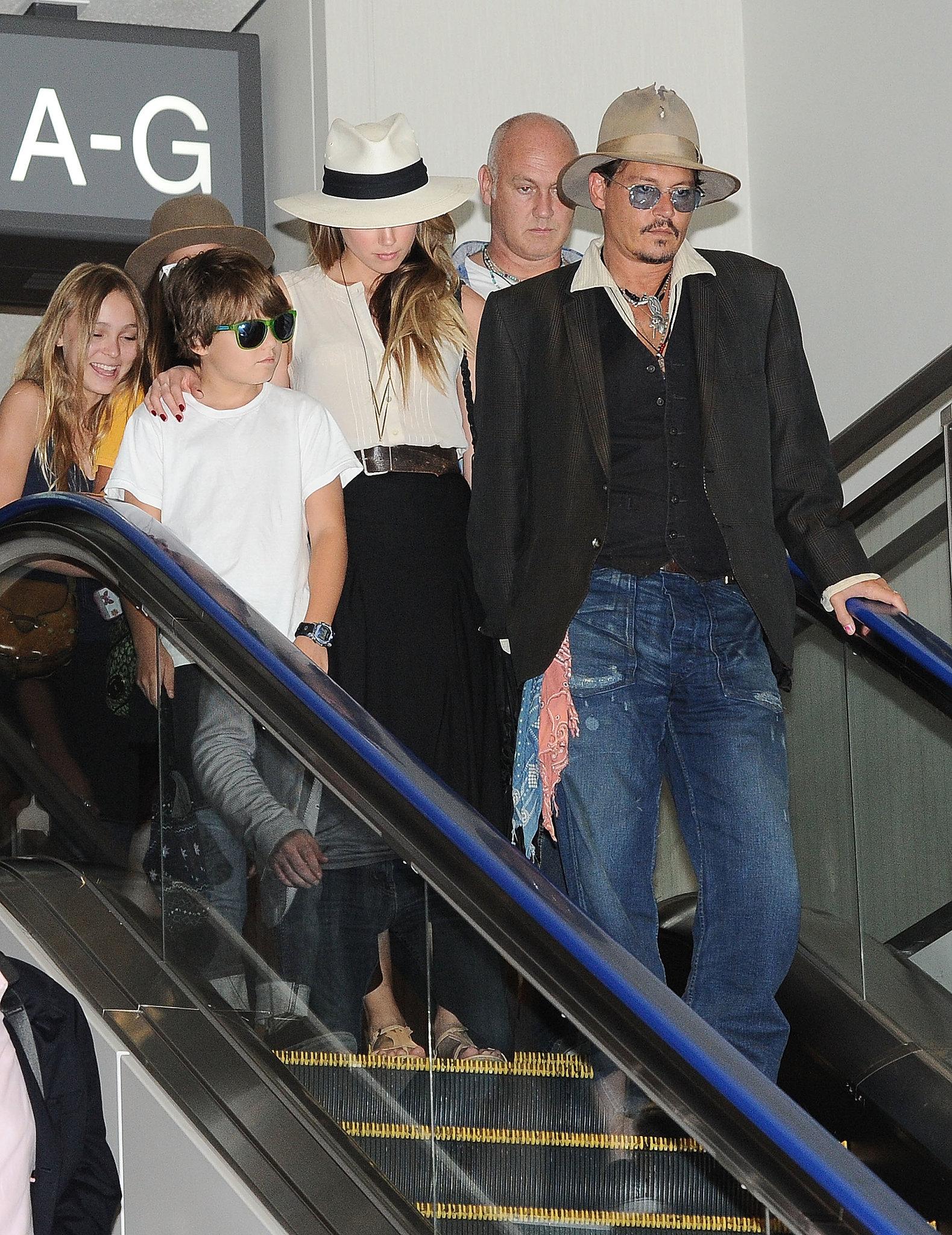 Amber Heard had her arm around Johnny Depp's son, Jack.