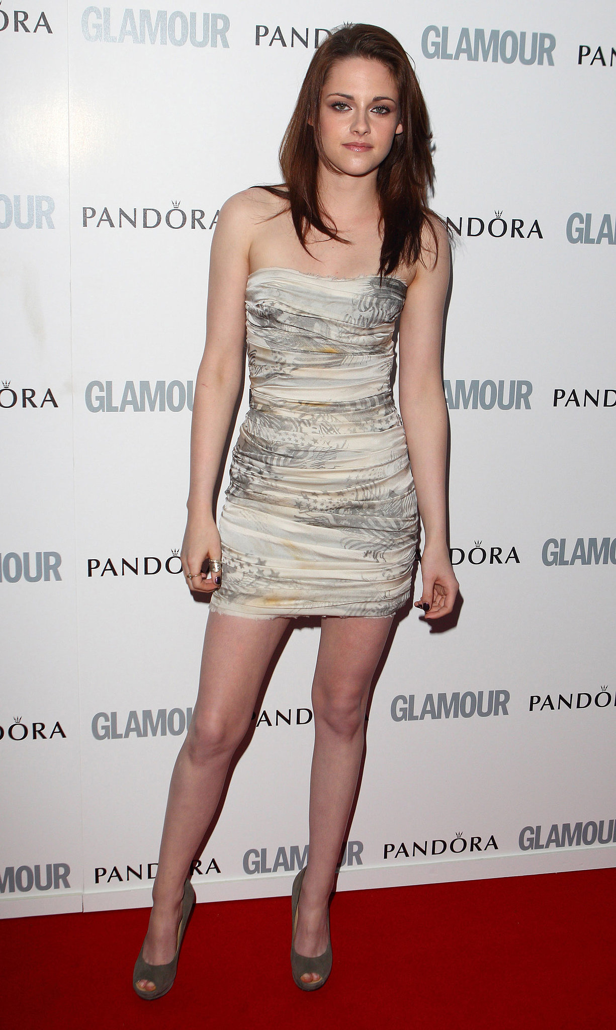 Stewart hit the red carpet in a ruched strapless Balmain and suede Giuseppe Zanotti peep-toe pumps for Glamour's Women of the Year Awards in 2011.