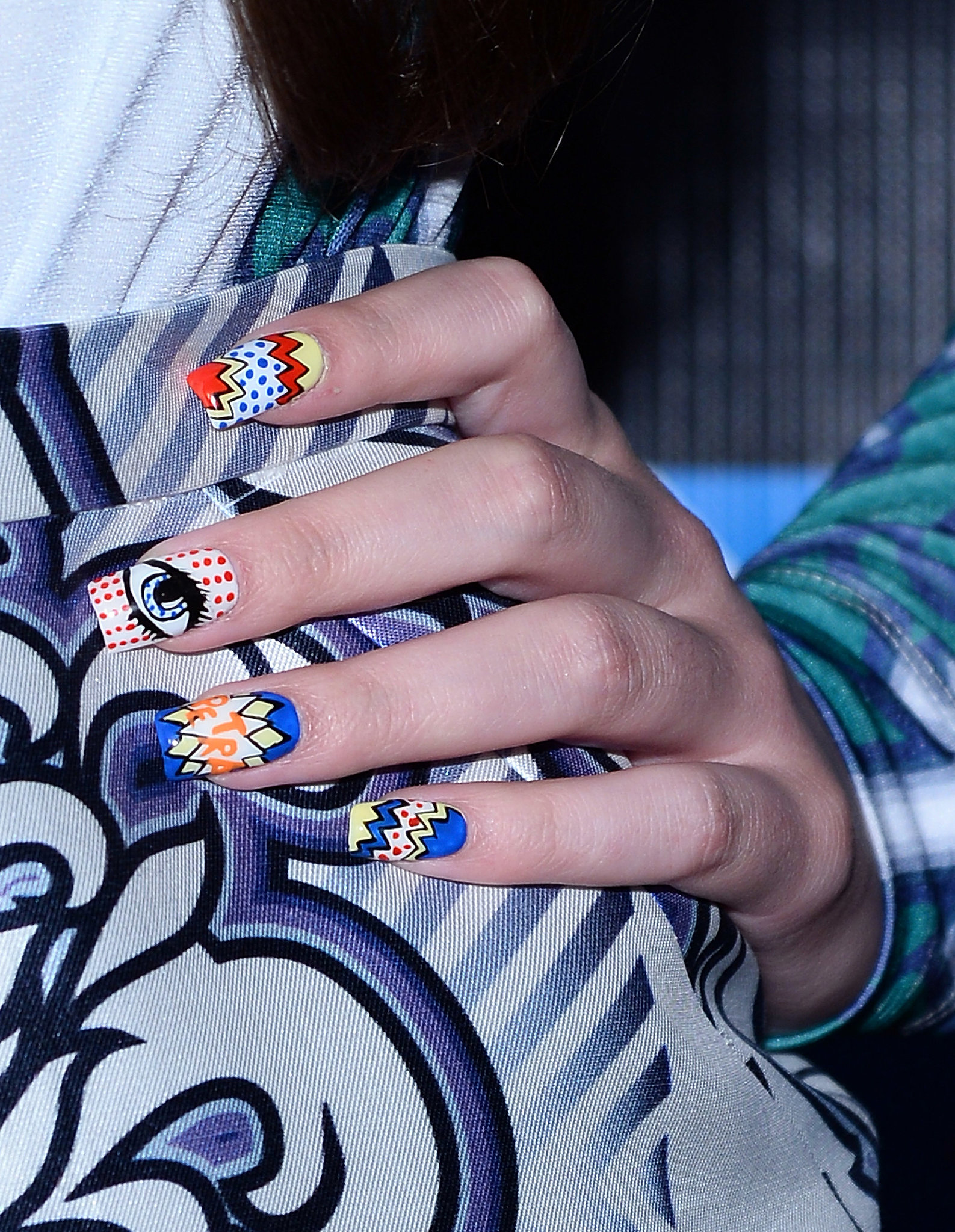 But the coolest part of Hailee's look was her nails, which featured comic-book-inspired pop art.