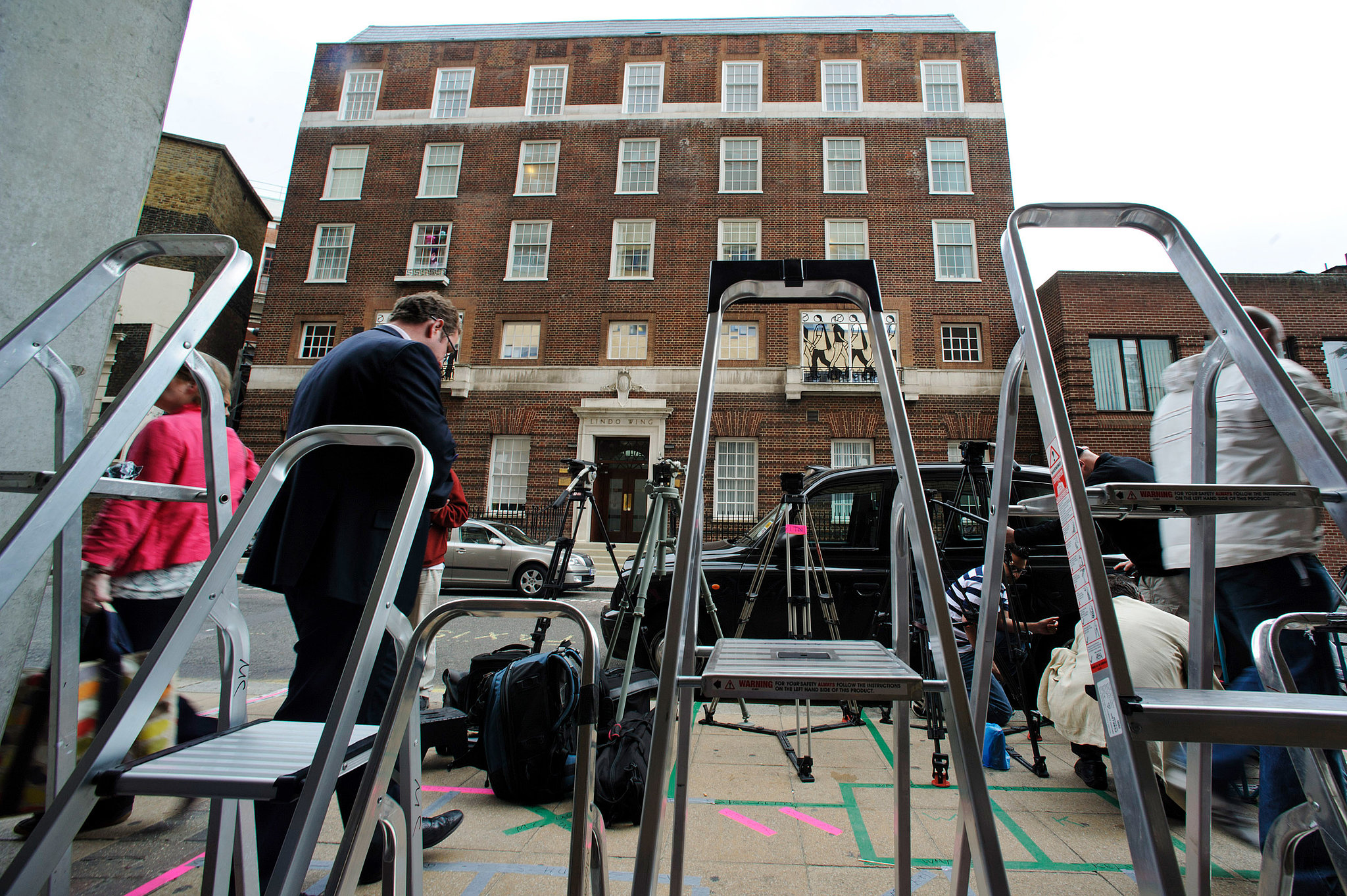 Press ladders are lined up outside St. Mary's Hospital in London.